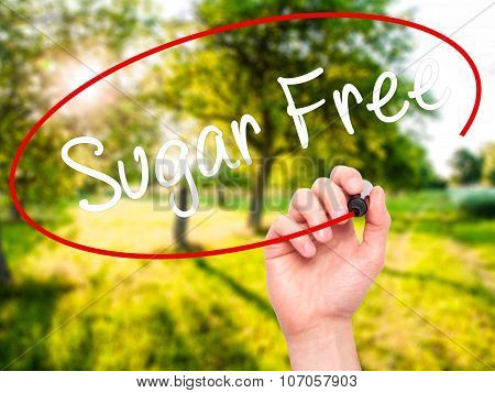 Man Hand writing Sugar Free with black marker on visual screen.
