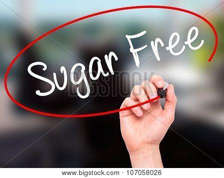 Man Hand writing Sugar Free with black marker on visual screen.
