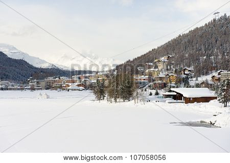 View to the frozen lake and buildings of St. Moritz, Switzerland.