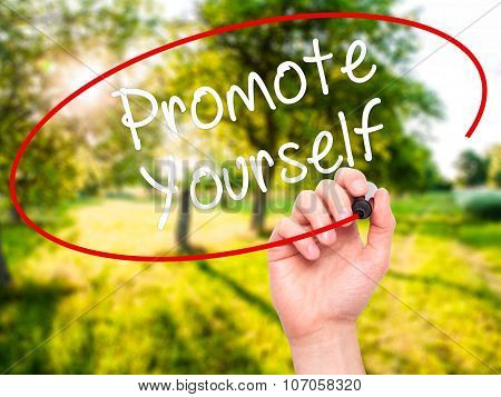 Man Hand writing Promote Yourself with black marker on visual screen.