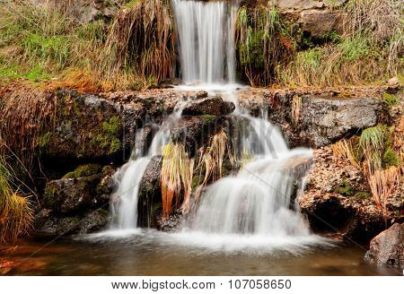 Beautiful waterfall in the forest during autumn