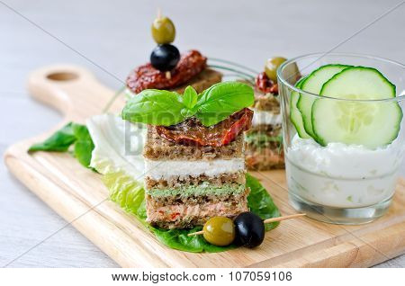 Rye Granary Bread Sandwich With Curd, Antipasto, Cucumber And Basil