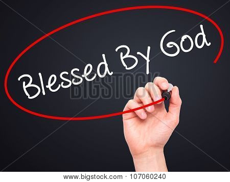 Man Hand writing Blessed By God with black marker on visual screen.