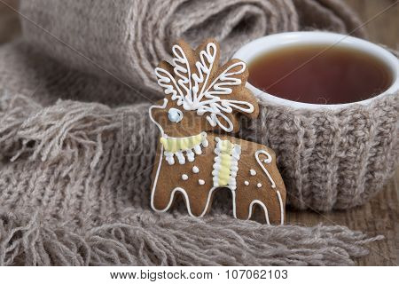 Christmas Cookies In The Form Of A Deer And A Cup Of Tea