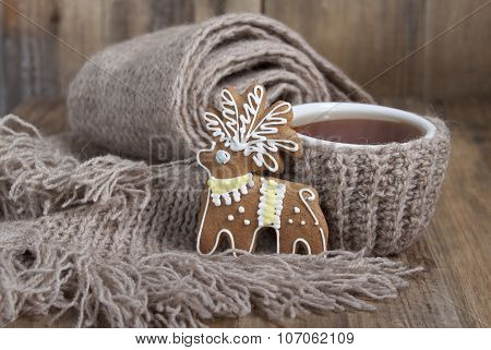 Christmas Cookies In The Form Of A Deer And A Cup Of Tea In A Scarf And A Scarf
