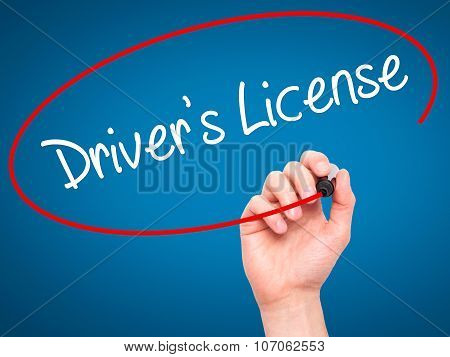 Man Hand writing Drivers License with black marker on visual screen.