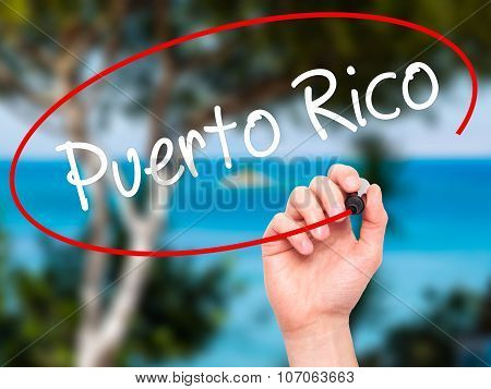 Man Hand writing Puerto Rico with black marker on visual screen