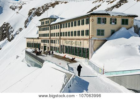 People walk by the terrace of the Pilatus-Kulm luxury hotel at the top of the Pilatus mountain.
