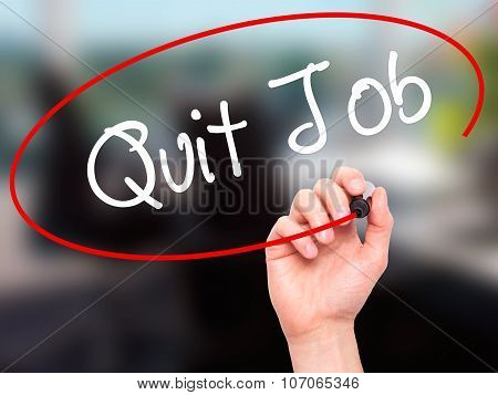 Man Hand writing Quit Job with black marker on visual screen.