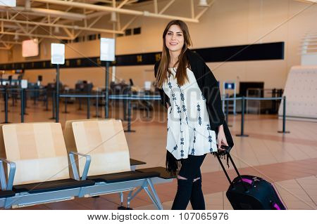 Young female waiting for her flight.