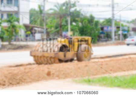 Blurred image motor grader, road construction work