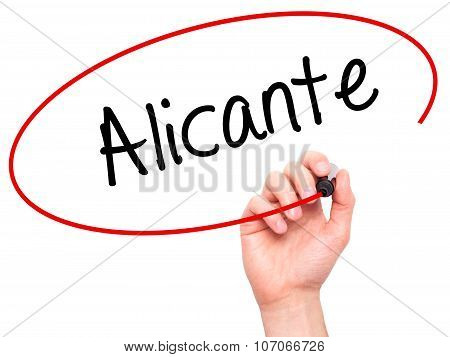 Man Hand writing Alicante with black marker on visual screen.