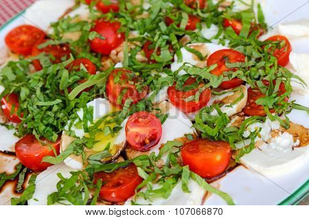 Fresh Caprese salad - Tomato, sliced Mozzarella cheese, Basil seasons with salt and olive oil