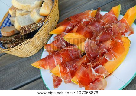 A3 - 4 - 02 Thin slices of Prosciutto served with fresh and juicy cantaloupe Melon