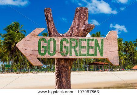 Go Green arrow with beach background