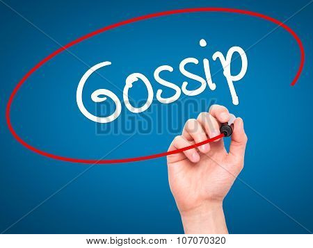Man Hand writing Gossip with black marker on visual screen.