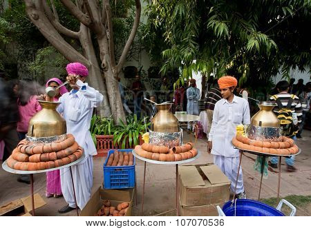 Two Men In Traditional Rajasthan Dresses Cooking Tea Masala During The Festival In India