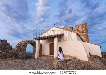 Woman Thinking In Front Of The Chapel