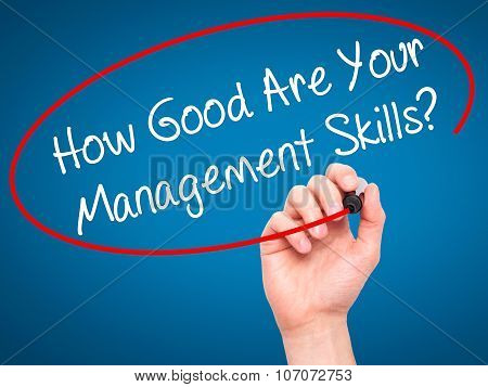 Man Hand writing How Good Are Your Management Skills? with black marker on visual screen.