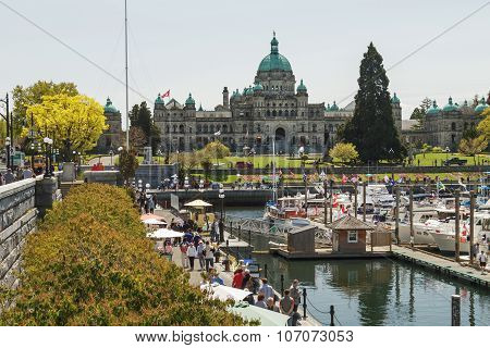 VICTORIA, BRITISH COLUMBIA, CANADA - MAY 19, 2010: Busy afternoon view of Inner Harbour in Victoria British Columbia CANADA.