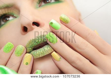 Green yellow manicure .