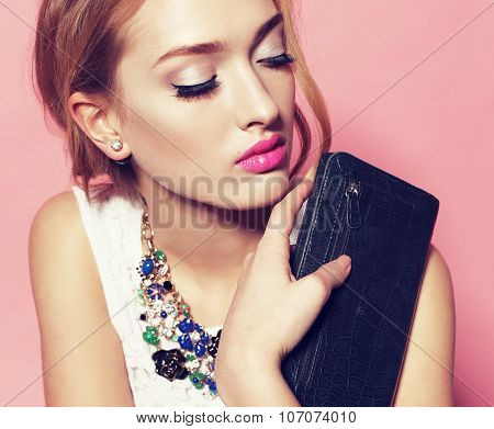 Gorgeous Woman Wears Elegant Dress And Necklace,holding Small Bag