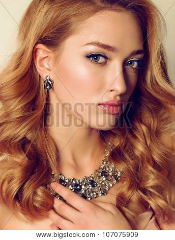 Portrait Of Young Woman With Blond Curly Hair Wears Luxurious Bijou