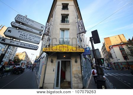 PARIS, FRANCE - SEP 09, 2014: Building of Hotel Metropole Lafayette between two streets in Paris