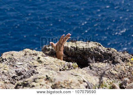 Hand Between Rocks