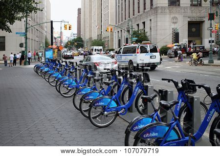 NEW YORK, USA - SEP 08, 2014:  Several blue bicycle in hire at the intersection of Central street and Worth street
