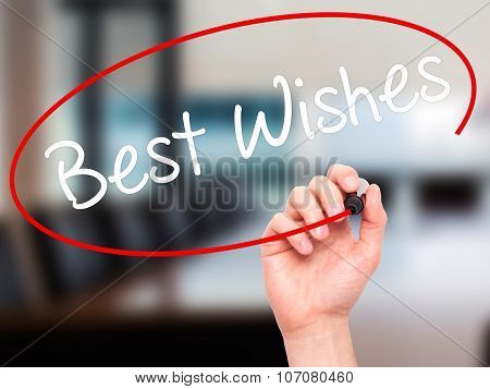 Man Hand writing Best Wishes with black marker on visual screen. Isolated on nature. Business, techn