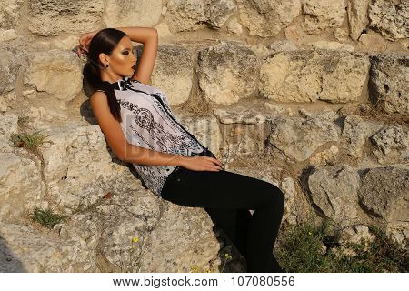 Sexy Elegant Woman With Dark Hair Wears White Shirt And Black Pants