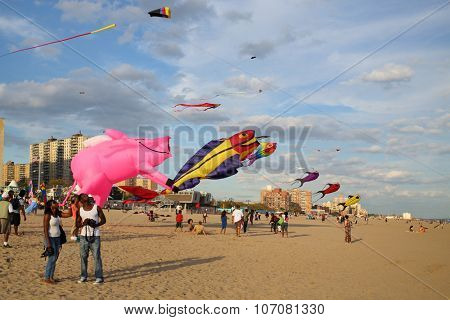 NEW YORK, USA - SEP 08, 2014: People fly kites on the beach near the New York Aquarium in Coney Island