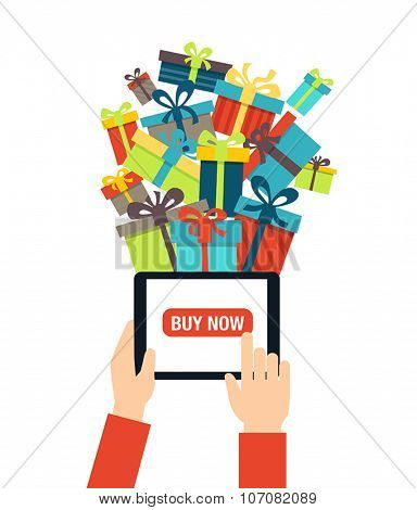 Online shopping - ordering gifts online. A person using modern technology - touch screen tablet for Christmas shopping.
