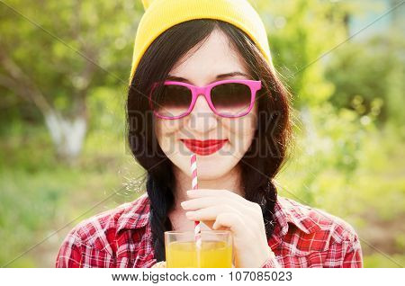 Fashion Girl Hipster In Glasses And Shirt Outdoors