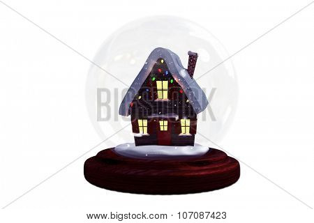Christmas cottage in snow globe on white background
