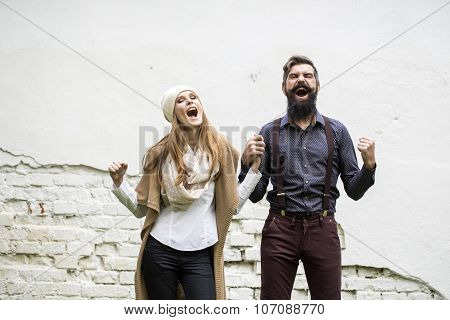 Emotional Couple Near Wall