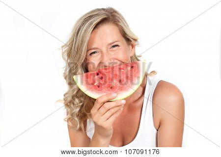 beautiful, young healthy, happy blond-haired woman smiling while holding a watermelon in his hands.