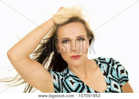 Woman In Black And Blue Shirt Close Hand In Hair Looking