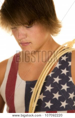Young Man In Flag Shirt With Rope Over Shoulder Close Look Down