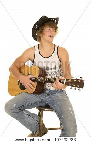 Young Man Playing A Guitar With Cowboy Hat Smile