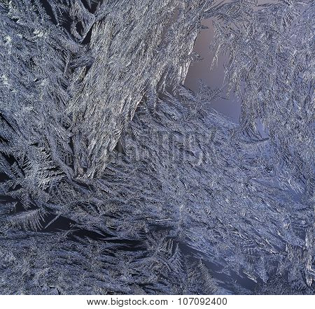 Macro, closeup of a frosty, icy glass window.