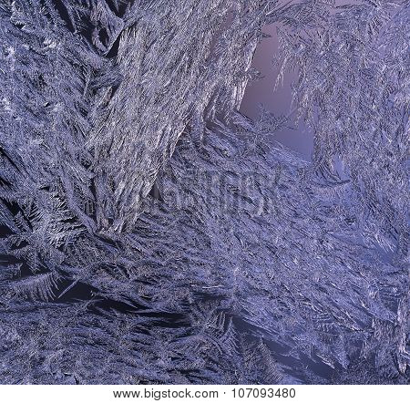 Macro, closeup of a frosty, icy glass window. Violet.