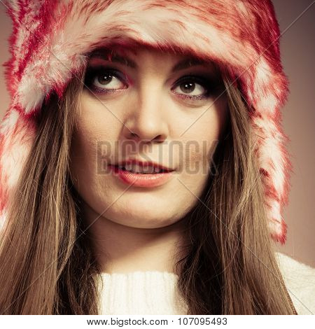 Woman Portrait In Winter Cap