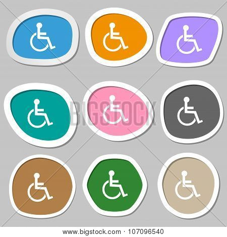 Disabled Sign Icon. Human On Wheelchair Symbol. Handicapped Invalid Sign. Multicolored Paper Sticker