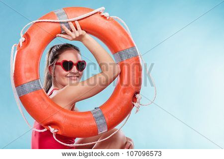 Happy Woman In Sunglasses With Ring Buoy Lifebuoy.