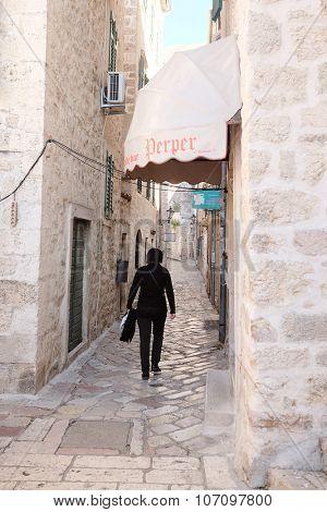 Kotor, Montenegro, October, 30, 2015: Tourists in the old town of Kotor, Montenegro