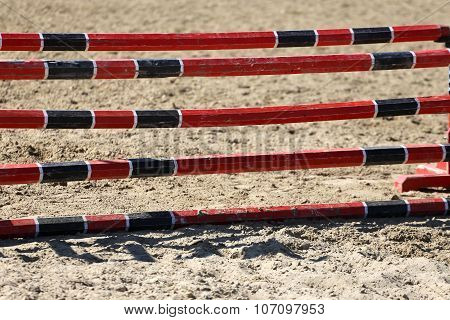 Red And Black Oxer On The Ground For Jumping Horses As A Background