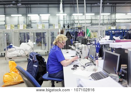 ST. PETERSBURG, RUSSIA - OCTOBER 30, 2015: Staff working in the automated mail sorting center of Russian Post. Russian Post is a strategic enterprise with 42,000 post offices and 351,000 employees