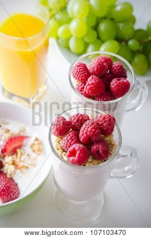 Glass Of Dessert With Fresh Berries, Muesli And Yoghurt